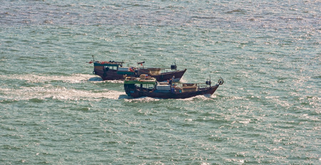 commercial fishing: Commercial fishing trawler boats near Hong Kong