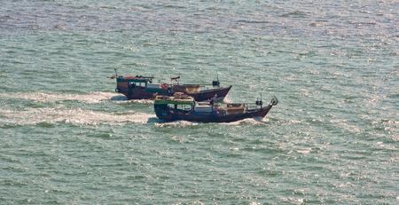 commercial fishing net: Commercial fishing trawler boats near Hong Kong