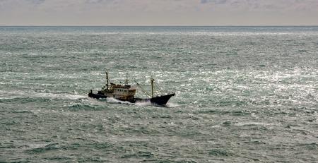 commercial fishing net: Commercial fishing trawler boat near Hong Kong
