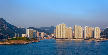 repulse: Sunset view to highrise residential apartments building in Repulse Bay, Hong Kong island