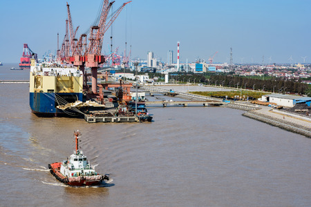 point of view: Tugboats from high point view against shipyard background. Shanghai, China