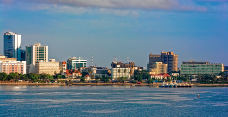 Sunset panorama of Dar Es Salaam City Centre with waterfront and ships