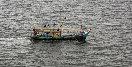 fishing fleet: Commercial fishing trawler boat near Singapore Stock Photo