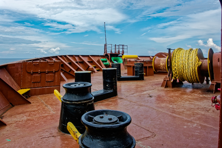 windlass: Equipment on forecastle deck of ship Anchor windlass on container cargo ship with mooring drum and warping head Stock Photo