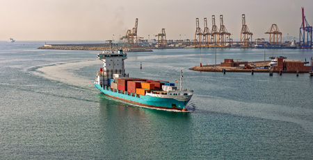 Container ship arriving port Valencia. Spain, Europe