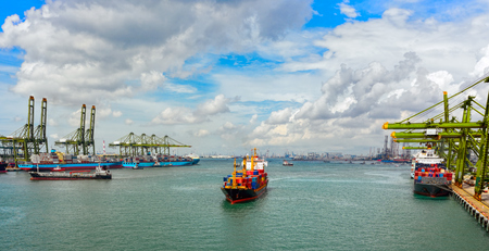 psa: Container ship arriving to Psa cargo container terminal, Keppel Harbour, Singapore, Malaysia.