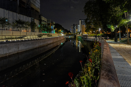 pedestrian bridges: Singapore night scenic illumination of Rochor Canal featuring look-out decks, rain gardens fitted with specially-selected plants, pedestrian walkway, bridges and benches Stock Photo