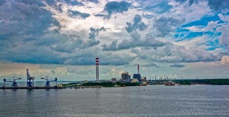 power giant: Giant coal-fired power station at waterfront in Johor, Malaysia.