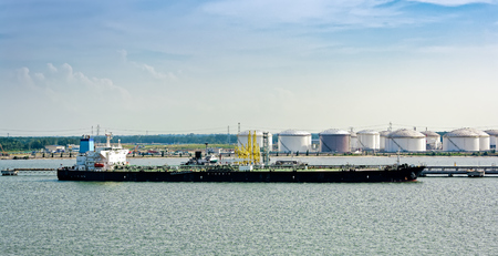 storage bin: Tanker in front of an oil storage terminal waiting for unloading at waterfront in Tanjung Bin, Johor, Malaysia.