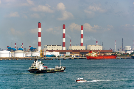 Power plant on the coast with oil tankers at the pier