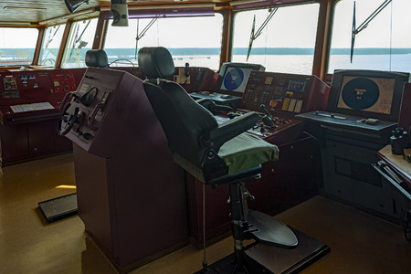 wheelhouse: Wheelhouse of modern container ship with various navigational equipment during an stay in the port