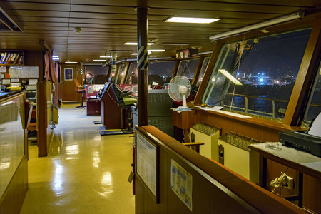 wheelhouse: Wheelhouse of modern container ship with various navigational equipment during an overnight stay in the port
