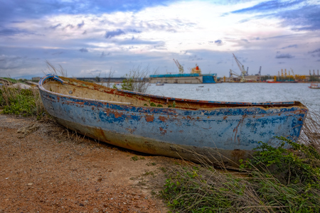 flaking: Old blue derelict wooden boat with flaking paint at the coastline of Laem Chabang, Chonburi, Thailand Stock Photo