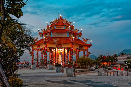 loi: Sunset view to shore with Guanyin Chinese shrine temple on Koh Loi at Sriracha, Chonburi province, Thailand