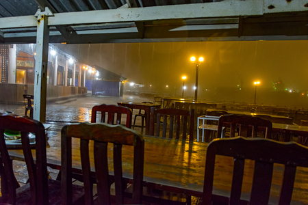 downpour: Evening tropical downpour from under the awning of the restaurant on the embankment of Laem Chabang, Chonburi, Thailand
