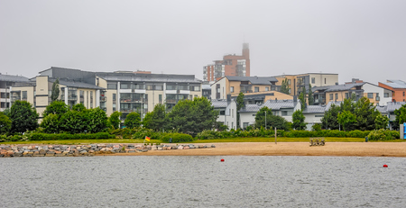 lowrise: Residential low-rise buildings at shore of Finland Gulf in new district Herttoniemenranta of Helsinki, Finland