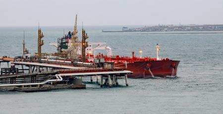 loading bay: Tanker in front of an oil storage terminal waiting for loading in Tsemesskaya (Novorossiyskaya) bay. Novorossiysk, Russia