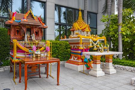 thai buddha: Traditional Thai spirit houses on a city centre