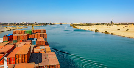 ship bow: Industrial container ship passing through Suez Canal with ships convoy, view on the bow from the captain bridge. Stock Photo