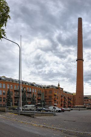 famous industries: The spinning mill of the former wool factory of Klingendahl in Tampere, Finland. The building was constructed in the early 1900s, was obviously expanded later and now converted tovarious offices and apartments. The smokestack was a part of the mills own
