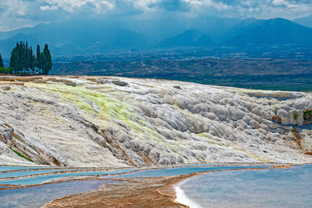 carbonate: Multicolored carbonate terraces and travertines with blue water - unique nature wonder in Pamukkale (cotton castle in Turkish), Turkey