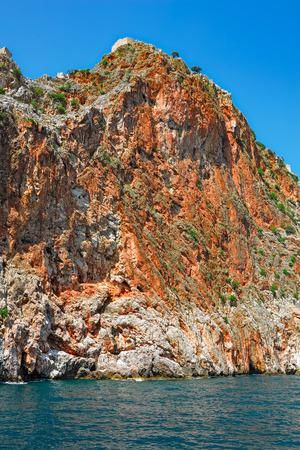 seljuk: Ruins of castle over rocky cliffs. Alanya, Turkey.