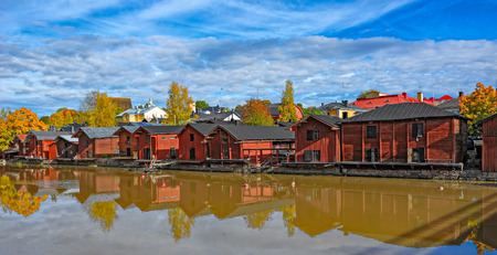 ochre: Riverside red ochre painted storage buildings and Cathedral in Old Porvoo at sunny autumn day