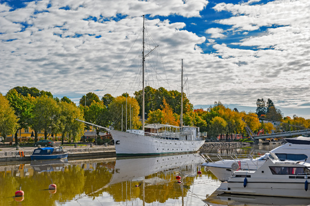 sail ship: Embankment of Porvoonjoki River and boats and sail ship docked along a river in Porvoo, Finland