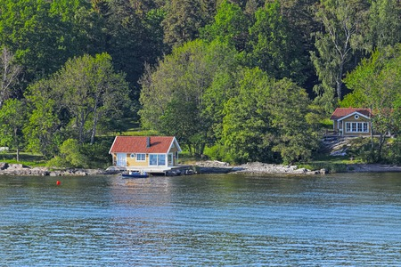 summerhouse: Wooden cabin on rocky shore of Stockholm archipelago, Sweden Stock Photo