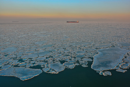 point of view: High point view to ice floes in Bohai Sea or Bo Sea, also known as Bohai Gulf or Bo Gulf, at sunset