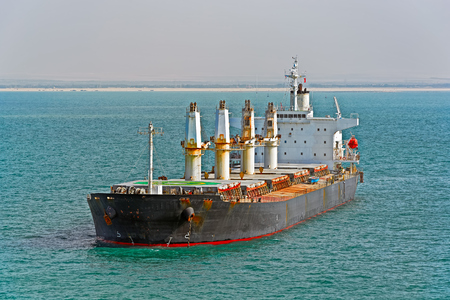 Bulk carrier: Loaded bulk carrier cargo ship anchored at Egypt Suez canal northbound Stock Photo