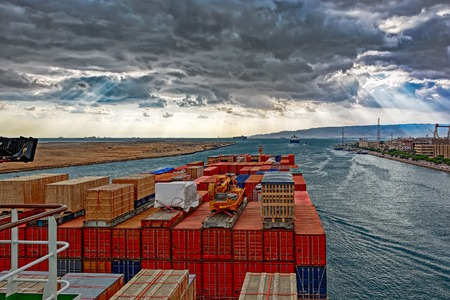 convoy: Industrial container ship passing through Suez Canal with ships convoy, view on the bow from the captain bridge. Stock Photo