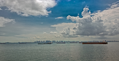 unload: Various cargo ships waiting to load and unload in the harbour at the busiest port of Singapore