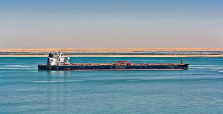 Loaded oil tanker ship entering to Egypt Suez canal northbound Stok Fotoğraf