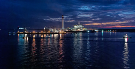 power giant: Night view of giant coal-fired power station at waterfront in Johor, Malaysia.