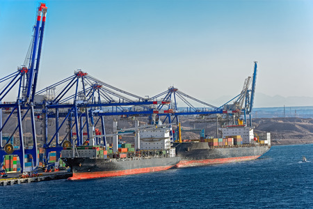 sightseeng: Ships moored on container terminal of port Aqaba, Red Sea, Jordan Stock Photo