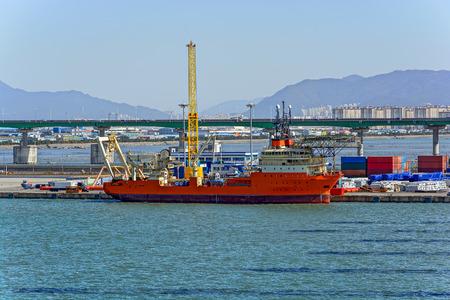 helipad: Cable Layer vessel with helipad onboard in Gadeokdo port, South Korea. Stock Photo