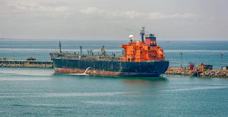 ballast: Crude oil tanker pumping ballast water in Lagos, Nigeria, Africa Stock Photo