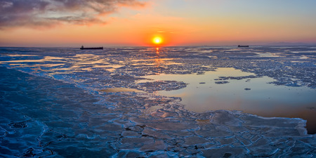 bo: Panoramic view to ice floes in Bohai Sea or Bo Sea, also known as Bohai Gulf or Bo Gulf, at sunset