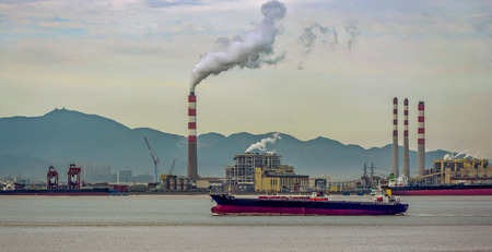 power giant: Giant coal-fired power station at waterfront in  in Beilun District, Ningbo, Zhejiang, China.