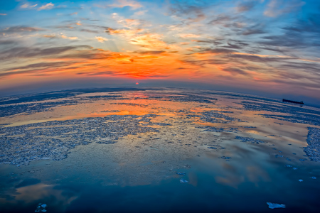 ice floes: Wide angle view to ice floes in Bohai Sea or Bo Sea, also known as Bohai Gulf or Bo Gulf, at sunset Stock Photo