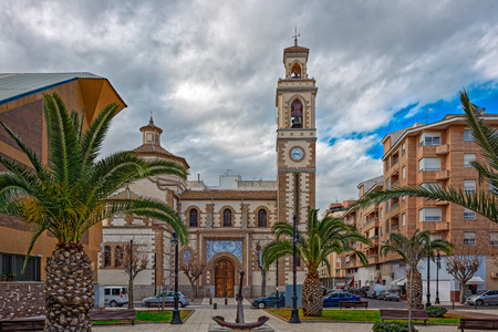 apostle: Church of St. Peter the Apostle with a bell tower, clock and a Alberto Guallart ceramics above the main entrance in Castellon, Spain. Church re-built on the site of the destroyed during the Civil War In 1939
