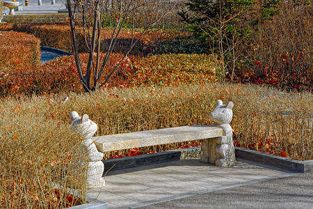 granite park: Granite garden decoration sculptured bench with animals holding them up in city park in Qinhuangdao, China