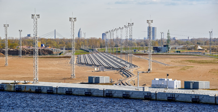 electricity supply: New railroad tracks of freight station and electricity supply in railway yard in cargo port Stock Photo