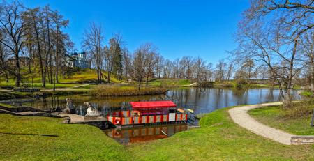 pacification: Castle Park is built around the 1832; the landscape includes the medieval castle ruins and the impressive ancient Riekstu castle- hill silhouette. Cesis, Latvia Stock Photo