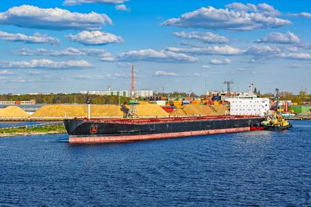 Bulk carrier cargo ship waiting to load in freeport of Riga, Latvia