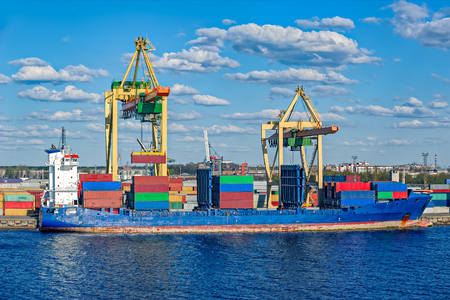 gantry: Loading container ship with large gantry cranes in Riga, Latvia