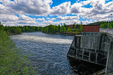 spillway: Spillway of hydroelectric power generation plant dam at Oat rapids of Kymijoki main stream in Mankala, Finland. Whitewater height of fall of 8.1 meters and a power plant of 25 MW.