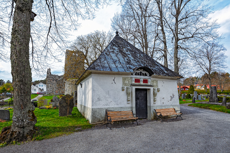 outhouse: Outhouse at St. Marys church and medieval graveyard in Sigtuna, Sweden Stock Photo