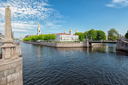 sightseers: Canal bridges and St Nicholas Naval Cathedral, Saint Petersburg, Northwestern Region, Russia Stock Photo